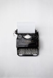 """A photo of an old-fashioned black """"Favorit"""" typewriter."""